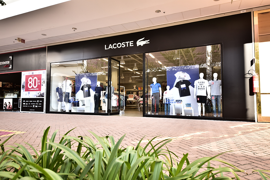 LACOSTE, located at Chicago Premium Outlets®: Lacoste is famous today for its iconic polo shirt, available in a wide colour palette every season, but more broadly offers sportswear apparel for men and women, as well as shoes, eyewear, watches, fragrances, handbags and luggage, belts and home textile.